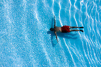 Man in swimming pool view from above