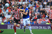 Denver Hume and Matty Done during the EFL Sky Bet League 1 match between Sunderland and Rochdale at the Stadium Of Light, Sunderland, England on 22 September 2018.