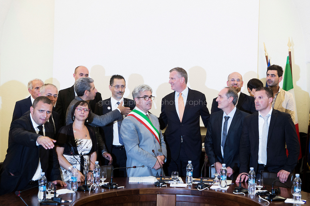 GRASSANO, ITALY - 24 JULY 2014:  Mayor of New York Bill de Blasio thanks local council men for the title of of honorary citizenship given to him during a ceremony at the city council in Grassano, his ancestral home town in Italy, on July 24th 2014.<br /> <br /> New York City Mayor Bill de Blasio arrived in Italy with his family Sunday morning for an 8-day summer vacation that includes meetings with government officials and sightseeing in his ancestral homeland.