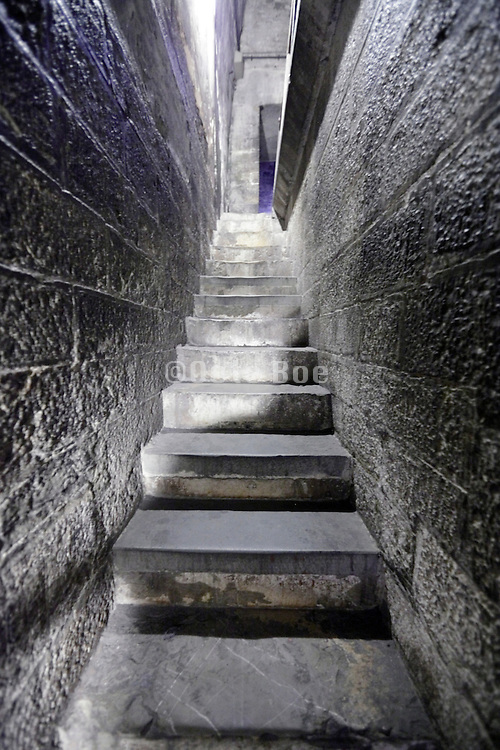 narrow stairs corridor inside medieval tower