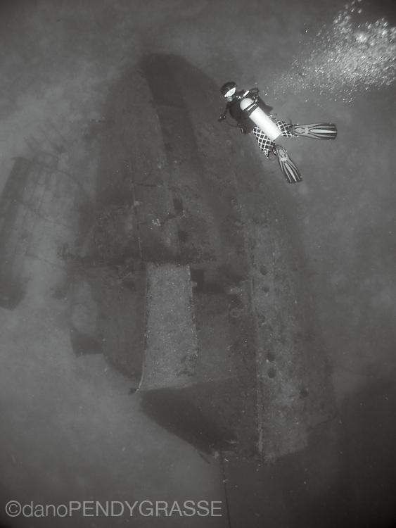 A scuba diver descends onto the wreck of the El Aguila in Roatan, Honduras.