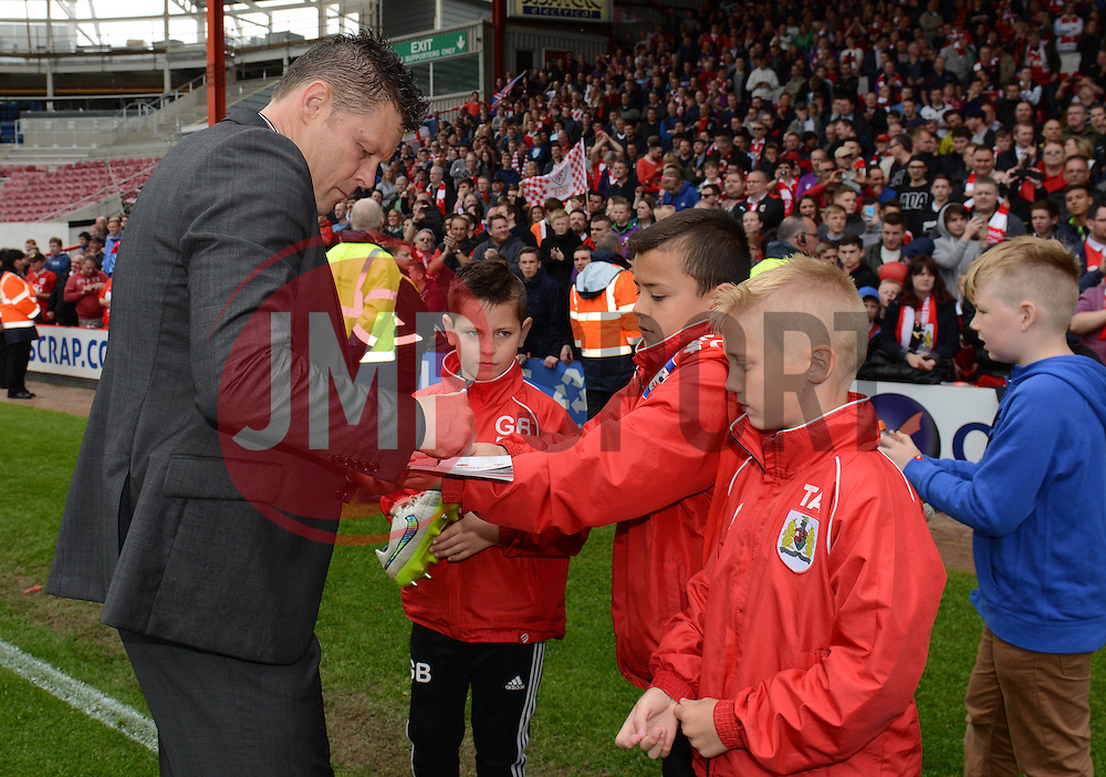 Bristol City manager, Steve Cotterill signs autographs - Photo mandatory by-line: Dougie Allward/JMP - Mobile: 07966 386802 - 03/05/2015 - SPORT - Football - Bristol - Ashton Gate - Bristol City v Walsall - Sky Bet League One