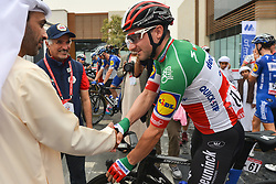 March 1, 2019 - Ajman, United Arab Emirates - Sheikh Ahmed bin Humaid Al Nuaimi, Chairman of the Economic Department of Ajman Emirate meets with Italian rider, Elia Viviani of Deceuninck - Quick Step Team, at the start line of the sixth Rak Properties Stage of UAE Tour 2019, a 180km with a start from Ajman and finish in Jebel Jais. .On Friday, March 1, 2019, in Ajman, Ajman Emirate, United Arab Emirates. (Credit Image: © Artur Widak/NurPhoto via ZUMA Press)