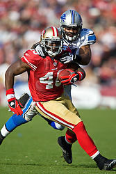 Dec 27, 2009; San Francisco, CA, USA;  San Francisco 49ers tight end Delanie Walker (46) is tackled from behind by Detroit Lions linebacker DeAndre Levy (54) during the second quarter at Candlestick Park. San Francisco defeated Detroit 20-6.