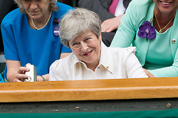 © Licensed to London News Pictures. 13/07/2019. London, UK.  British Prime Minster Theresa May watches the ladies singles finals on centre court tennis on Day 12 of the Wimbledon Tennis Championships 2019 held at the All England Lawn Tennis and Croquet Club. Photo credit: Ray Tang/LNP