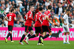 Wayne Rooney and Memphis Depay of Manchester United celebrate after Juan Mata (not pictured) scores a goal to make it 0-1 - Mandatory byline: Rogan Thomson/JMP - 07966 386802 - 30/08/2015 - FOOTBALL - Liberty Stadium - Swansea, Wales - Swansea City v Manchester United - Barclays Premier League.