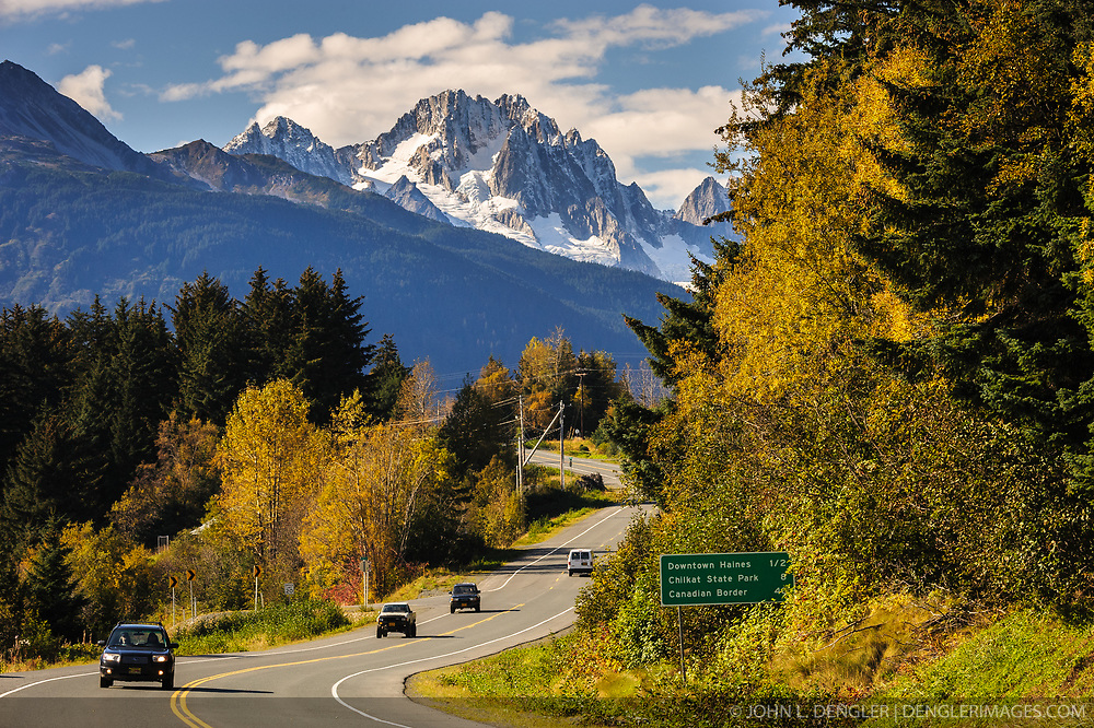 Fall colors and a scenic view of Mt. Emmerich greet visitors to Haines, Alaska. Haines is a cruise ship destination on the Lynn Canal in southeast Alaska. The Haines Highway provides road access to the continental highway system. The photograph was taken at Picture Point on AK-7 (Lutak Road).<br /> <br /> Haines, Alaska, a picturesque town in southeast Alaska, is located on the Lynn Canal between the towns of Skagway and Juneau. Haines is one of the few towns in southeast Alaska that is connected with the North American highway system. The Haines Highway (Alaska Route 7 or AK-7) travels through British Columbia and the Yukon (Yukon Highway 3) to connect with the Alaska Highway in Haines Junction, Yukon.<br /> <br /> Haines is also a stop on the Alaska Marine Highway System with ferries arriving from Skagway and Juneau.<br /> <br /> Wildlife viewing opportunities are abundant. The Alaska Chilkat Bald Eagle Preserve on the Chilkat River, near the confluence with the Tsirku River near Klukwan, is famous for its large concentration of bald eagles in the fall. At its peak in November, the American Bald Eagle Foundation sponsors the Alaska Bald Eagle Festival.