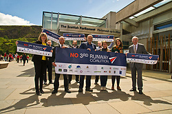 Pictured: Members of the No 3rd Runway Coalition were joined by MSPs, Alison Johnstone (Green Party) MPatrick Harvie (Green Party) Andy Whghtman (Green Party), and Neil Gil Patterson (SNP)<br /> <br /> The No 3rd Runway Coalition was at the Scottish Parliament today to urge the SNP to change their position on supporting the Heathrow third runway proposal and to send the UK Government a message to 'think again'. Campaigners will be joined by MSPs from Scottish Greens, and SNP to highlight the environmental damage to Scotland and the rest of the UK that building a third runway would mean, as well as the fact that Scottish airports would suffer as a result.  Campaigners also believe that the SNP appear to be too trusting of UK Government promises – particularly in relation to the impact on Climate Change commitments - as revealed by Keith Brown, Cabinet Secretary for Economy, Jobs and Fair Work, in response to a question from Patrick Harvie MSP in the Scottish Parliament last Thursday.<br /> <br /> The Labour party announced their formal opposition to the proposal on Wednesday, on the basis that the UK Government's Airports National Policy Statement failed all four of party's tests on climate change, delivering extra capacity, air pollution and benefits to be felt outside of London. Additionally, the long-awaited UK Government mitigation framework for international aviation emissions won't be published for many months after MPs have been asked to support the Heathrow proposal. A recent report by the New Economics Foundation seriously calls into question the economic case – using the Department for Transport's own measures; and this is before taking into account the economic impact of Brexit <br /> <br /> <br /> <br /> Ger Harley | EEm 21 June 2018