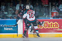 KELOWNA, CANADA - MARCH 25: Nick Merkley #10 of the Kelowna Rockets checks Brodi Stuart #17 of the Kamloops Blazers into the boards during first period on March 25, 2017 at Prospera Place in Kelowna, British Columbia, Canada.  (Photo by Marissa Baecker/Shoot the Breeze)  *** Local Caption ***