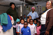 Children at the Sijongephambili creche, in the impoverished area of Lwandle township, Somerset West, Cape Town, are posing for a group picture.