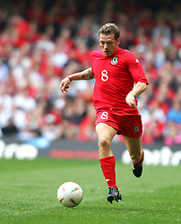 CARDIFF, WALES - SATURDAY MARCH 26th 2005: Wales' Craig Bellamy in action against Austria during the Wold Cup Qualifying match at the Millennium Stadium. (Pic by David Rawcliffe/Propaganda)