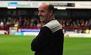 Paul Cook is all smiles before the Sky Bet League 2 match between Crawley Town and Portsmouth at the Checkatrade.com Stadium, Crawley, England on 18 August 2015. Photo by Michael Hulf.