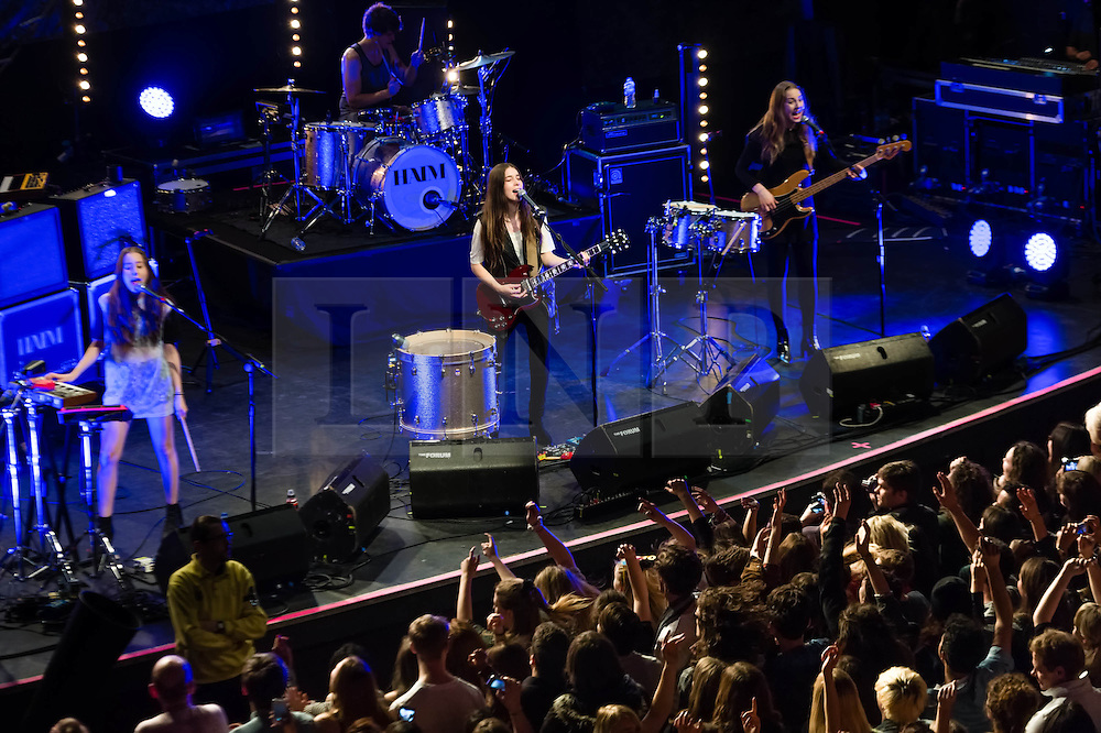 © Licensed to London News Pictures. 09/12/2013. London, UK.   Haim performing live at The Forum. In this pic - Alana Haim (left), Danielle Haim (centre), Este Haim (right). Haim is an American indie rock band consists of sisters Este Haim (bass/vocals), Danielle Haim (guitar/vocals) and Alana Haim (guitar/vocals/keyboards) with drummer Dash Huttong<br /> <br /> Haim were nominated in the Brand New for 2013 category in the 2013 MTV Music Awards, and won the Sound of 2013 category in the BBC Sound of 2013 awards. <br /> <br /> Photo credit : Richard Isaac/LNP