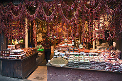 Loops of red peppers decorate the entrance to a spices and foodstuffs shop on the main street of Ciqikou Old Town, Chongqing, China.
