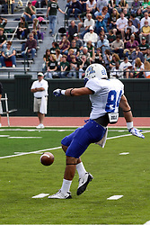 17 September 2011: Punter Jordan Peterson during an NCAA Division 3 football game between the Aurora Spartans and the Illinois Wesleyan Titans on Wilder Field inside Tucci Stadium in.Bloomington Illinois.