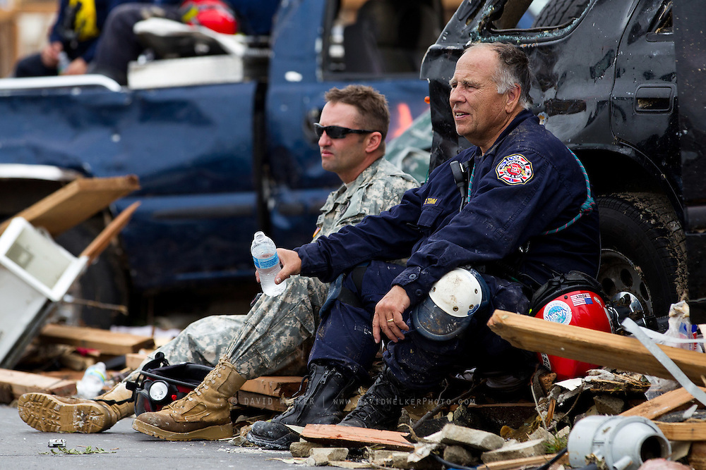 May 24, 2011- Members of St. Louis Metro search and rescue teams try and stay hydrated on a warm day in Joplin, Missouri after a Tornado came through the town on Sunday, May 22, 2011. Credit: David Welker / TurfImages.com