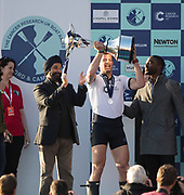 Mortlake/Chiswick, GREATER LONDON. United Kingdom. Oxford University BC, President Michael DI SANTO, lifts the Trophy after his crew win the 2017 Men's Boat Race winners as his OUBC Celebrate, The Championship Course, Putney to Mortlake on the River Thames.<br />