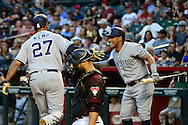 PHOENIX, AZ - MAY 28:  Yangervis Solarte #26 of the San Diego Padres congratulates Matt Kemp #27 after Kemp hit a solo home run in the first inning against the Arizona Diamondbacks at Chase Field on May 28, 2016 in Phoenix, Arizona.  (Photo by Jennifer Stewart/Getty Images)