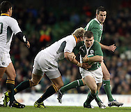 Photo © SPORTZPICS /SECONDS LEFT IMAGES 2010 - Ireland's Gordon D'Arcy (R) is tackled by Zane Kirchner.Jean de Villiers of South Africa - Ireland v South Africa - Guinness Series 2010 - Aviva Stadium - Dublin - Ireland - 06/11/10 - All rights reserved