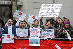© Licensed to London News Pictures. 08/05/2017. London, UK. Demonstrators gather outside Guildhall in the City of London as Aung Sang Suu Kyi arrives to receive a Freedom of the City award.  The demonstrators are protesting against ethnic cleansing of the Rohingya Muslim minority in Myanmar. Photo credit : Stephen Chung/LNP