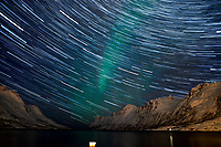 Star Trails and Northern Lights. Chasing the Northern Lights. Ersfjord, Kvaløya (Whale Island). Composite of 148 images taken with a Nikon D800 camera and 24 mm f/1.4 lens (ISO 800, 24 mm, f/1.4, 8 sec).