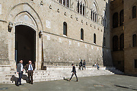 SIENA, ITALY - 20 MARCH 2015: The headquarters of the Monte dei Paschi di Siena bank at Palazzo Salimbeni in Siena, Italy, on March 20th 2015. <br /> <br /> Siena, a Tuscan city and UNESCO World Heritage Site, is home to Monte dei Paschi di Siena, the world's oldest surviving bank and Italy's third largest bank. The bank, founded in 1472, was the largest employer in Siena, and it helped finance a host of community projects and services until it stumbled during the financial crisis started in 2008.