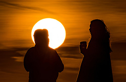 © Licensed to London News Pictures. 30/01/2018. London, UK. Visitors to the top of Primrose Hill enjoy the sunrise over central London. Photo credit: Peter Macdiarmid/LNP