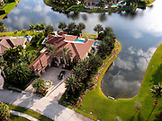 Aerial view of estate home on the water