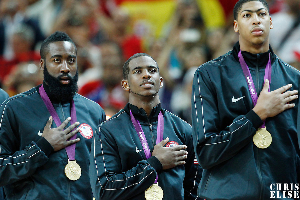 12 August 2012: USA James Harden, Chris Paul and Anthony Davis stand during the National Anthem following 107-100 Team USA victory over Team Spain, during the men's Gold Medal Game, at the North Greenwich Arena, in London, Great Britain.