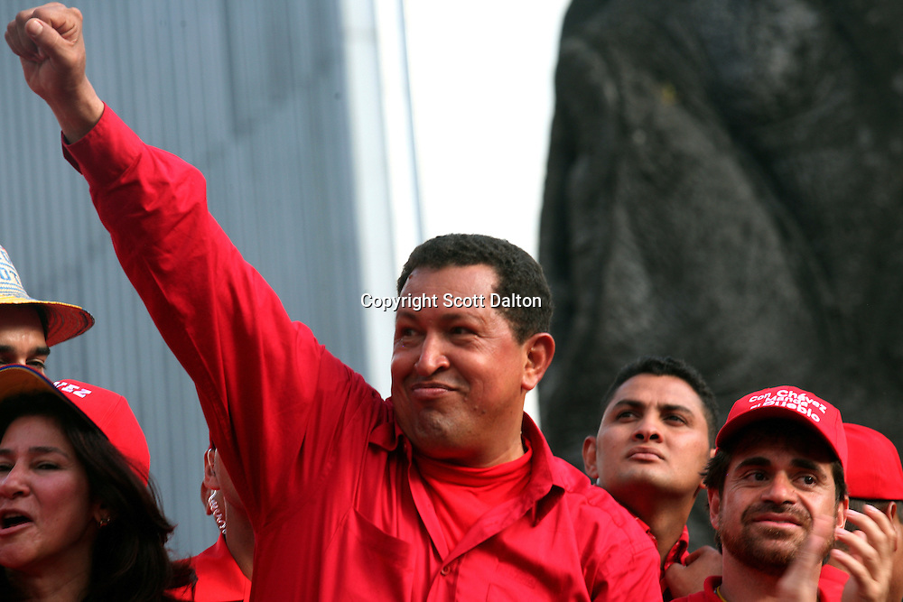 President Hugo Chavez gestures to supporters as he rides on a caravan back to the presidential palace after his closing campaign rally in Caracas on Sunday, November 26, 2006. (Photo/Scott Dalton)