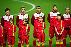 SWANSEA, WALES - Tuesday, March 26, 2013: Wales' Ben Davies, Andy King, Hal Robson-Kanu, Joe Ledley line-up before the 2014 FIFA World Cup Brazil Qualifying Group A match against Croatia at the Liberty Stadium. (Pic by Tom Hevezi/Propaganda)