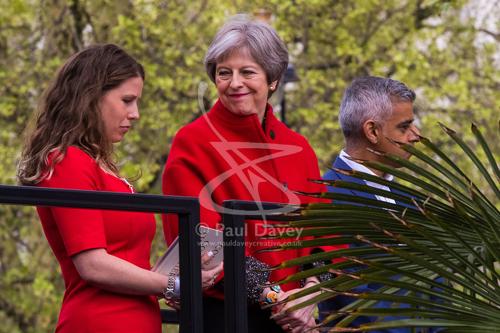 Caroline Criado-Perez, left whose campaign and petition led to the erection of the statue stands with Prime Minister Theresa May and Mayor of London Sadiq Khan. A statue designed by Turner Prize-winning artist Gillian Wearing OBE of suffragist leader Millicent Fawcett is unveiled in Parliament Square by XXXX. The sculpture is the first-ever monument to a woman and the first designed by a woman to stand within the square and follows the successful campaign by feminist campaigner Caroline Criado-Perez who organised an 85,000 signature petition. London, April 24 2018.