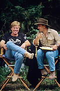 "BOZEMAN, MT - AUGUST:  Robert Redford and Philip Caputo discuss the filming of ""A River Runs Though It"" while on set in 1991. (Photo by John Kelly/Getty Images)"