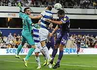Football - 2019 / 2020 EFL Carabao (League) Cup - Second Round: Queens Park Rangers vs. Portsmouth<br /> <br /> Gareth Evans of Portsmouth jumps with Todd Kane and goalkeeper, Liam Kelly, at Kiyan Prince Foundation Stadium (Loftus Road).<br /> <br /> COLORSPORT/ANDREW COWIE