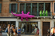 Pink alligators were a common sight along Venice's Grand Canal such as this alligator and his three bear friends hanging above Versace as part of the Venice Biennale Summer 2007. Italy.