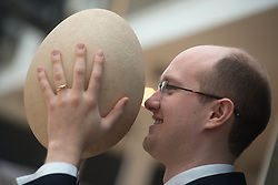 © Licensed to London News Pictures. 27/03/2013. London, UK. James Hyslop, a Scientific Specialist at Christie's auction house holds a complete sub-fossilised elephant bird egg on March 27, 2013 in London, England. This elephant bird egg which measuring 100 times the average size of a chicken egg is expected to fetch 30,000 GBP when it features in Christie's sale, which is to be held on April 24, 2013..Photo credit : Peter Kollanyi/LNP