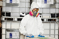 Portrait of female technician in hazmat suit and gas mask