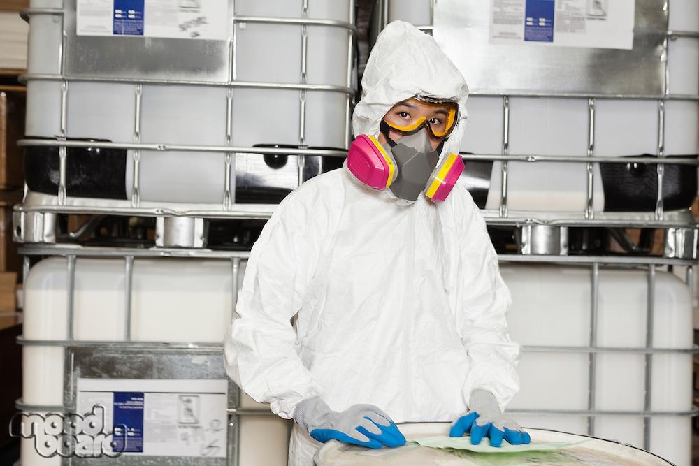 Portrait of female technician in hazmat suit and gas mask