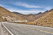 State Highway 8 snaking into the distance through Lindis Pass,, Otago, New Zealand