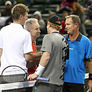 March 1, 2014, Indian Wells, California: <br /> Peter Fleming, John McEnroe, Jim Courier, and Rick Leach shake hands after their doubles match at the McEnroe Challenge for Charity presented by Esurance in Stadium 2 at the Indian Wells Tennis Garden. <br /> (Photo by Billie Weiss/BNP Paribas Open)