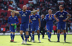 Cardiff City's Aron Gunnarsson celebrates with the fans after the final whistle
