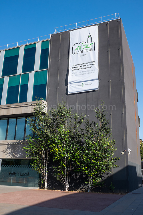 """Ciutat Refgi"" - Refugee City - refugees welcome banner on the ajuntament, city council building in Sant Cugat del Valles, Barcelona, Catalonia, Spain."