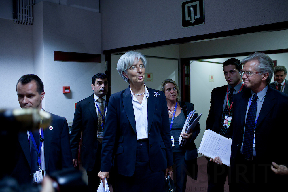 Managing Director of the IMF Christine Lagarde and her staff arrives for a media conference after the EU summit of eurogroup members at the EU Council building in Brussels on Thursday, July 21, 2011. PHOTO: ERIK LUNTANG / INSPIRIT Photo.