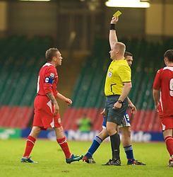 CARDIFF, WALES - Saturday, October 11, 2008: Wales' captain Craig Bellamy is shown the yellow card by referee Thomas Vejlgaard during the 2010 FIFA World Cup South Africa Qualifying Group 4 match against Liechtenstein at the Millennium Stadium. (Photo by Gareth Davies/Propaganda)