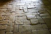 Old stone floor in the ancient church at St Amand de Coly in the Dordogne, France
