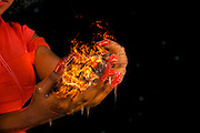 African model with a ball of fire in her hands. Famous humourous quotes series: People assume that time is a strict progression of cause to affect, but actually, from a non-linier, non subjective point of view it is more like a big ball of wibbily wobbly timey wimey...stuff