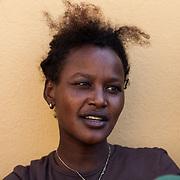 ragazza eritrea cristiana, è sbarcata a Lampedusa dopo essere passata da Sudan e Libia. Vuole chiedere asilo politico alla Norvegia.