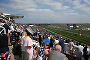 Crowds enjoy the sunshine and racing at The Randox Health Grand National on Grand National Day at at Aintree, Liverpool, United Kingdom on 14 April 2018. Picture by Craig Galloway.