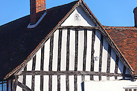 Pargetted fleur de lis symbols on the 16th century timber studded gable of a medieval house in Lavenham, Suffolk, UK.