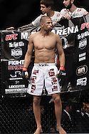 "MANCHESTER, ENGLAND, NOVEMBER 14, 2009: Andre Winner stands ready in his corner during ""UFC 105: Couture vs. Vera"" inside the MEN Arena in Manchester, United Kingdom."